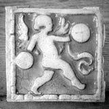 Cherub Architectural Salvage. Vintage square tile in monochrome black and white Stock Image