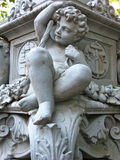 Cherub at base of New York City street lamp Royalty Free Stock Image