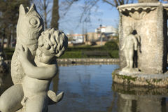 Cherub boys with fish Royalty Free Stock Images