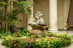 Cherub Fountain in Garden Stock Images