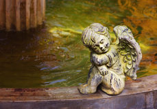Cherub next to the fountain Royalty Free Stock Photos