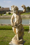 The cherub. Old statue of a cherub in a park Royalty Free Stock Photography