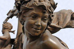 Cherub on the Pont Alexandre III Bridge Paris. This cherub is of one of the many sculptures lining the Pont Alexandre III bridge which spans the Seine River in royalty free stock photography
