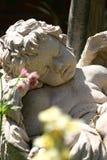 Cherub rock 3. Sleeping cherub statue in garden in sunshine Stock Photography