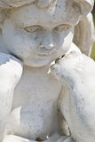 Cherub Statue. Close up of an old cherub statue Stock Image