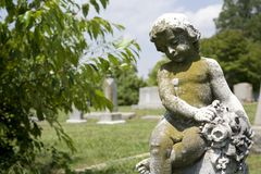 Cherub statue at graveyard. Royalty Free Stock Images