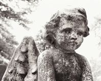 Cherub statue in graveyard Royalty Free Stock Photography