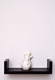 Cherub statue on shelf Royalty Free Stock Photo