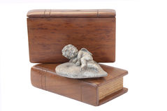 Cherub On Top Of Two Wooden Covered Bibles Stock Photography