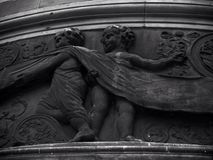 Cherubs. Black and white image of cherubs which form part of the architecture of a building. Black and Stock Photo