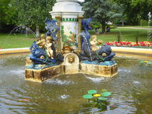 Cherubs on dolphins water fountain Stock Images