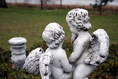Cherubs in garden Stock Photos
