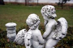 Cherubs in garden. Statue cherubs in garden stock photos