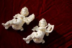 Cherubs on velvet Stock Photos