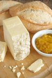 Cheshire cheese. Cheshire a traditional white and crumbly English cheese served with bread and pickle royalty free stock photo