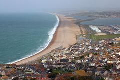 Chesil beach from Portland, United Kingdom. Looking along chesil beach from a hill in Portland, United Kingdom. Chesil beach joins Portland to the mainland at Stock Images