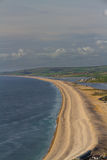 The Chesil Beach, seen from Portland Bill. Chesil bank, viewed from Portland Bill. Weymouth, Dorset, England, United Kingdom Royalty Free Stock Photos