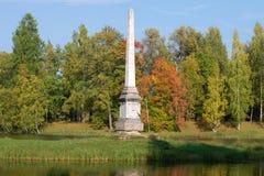 Chesma obelisk closeup, sunny september day. The Gatchina Palace Park. GATCHINA, RUSSIA - SEPTEMBER 24, 2016: Chesma obelisk closeup, sunny september day. The Stock Photo