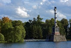 Chesme Column in Catherine park, St. Petersburg, Russia. Pushkin, St. Petersburg, Russia - September 20, 2015: Chesme Column in the Grand pond of the Catherine Stock Images