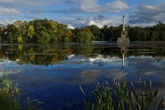 Chesme Column in Catherine park, St. Petersburg, Russia. Pushkin, St. Petersburg, Russia - September 20, 2015: Chesme Column in the Grand pond of the Catherine Royalty Free Stock Images