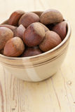 Chesnuts in bowl Stock Images