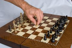 Chess 01. Man playing chess Royalty Free Stock Image