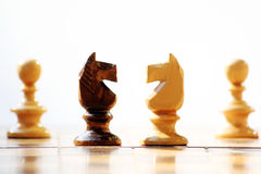 Chess. Two white pawns and two horses Royalty Free Stock Images