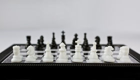 Chess. A Chessboard in the grey background royalty free stock photography