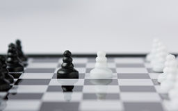 Chess. A Chessboard in the grey background Stock Photography