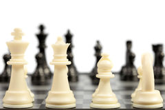 Chess. White chessmen on a chessboard Stock Image