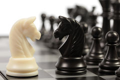 Chess. White and black chessmen on a chessboard Stock Photography