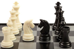 Chess. White and black chessmen on a chessboard Stock Image