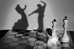 Chess. Kingdom drama black child negro shadow Stock Images