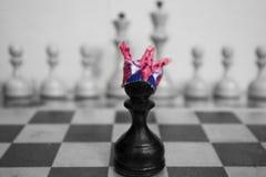 Chess. Kingdom drama black shadow clown cap Royalty Free Stock Photo