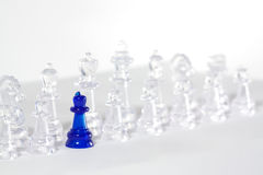 Chess. Some chess on white board with blue queen Royalty Free Stock Image