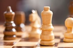 Chess. Close up of chess pieces on the board, shallow depth of field Stock Photo