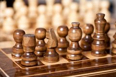 Chess. Close up of chess pieces on the board, shallow depth of field Stock Photos