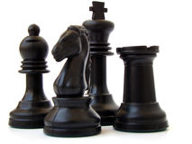 Chess. Closeup of some chess figures on white background stock photo