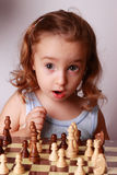 Chess. A child and a chessboard Royalty Free Stock Photography