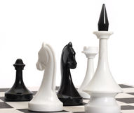 Chess. On photo chess pieces isolated on a white background Royalty Free Stock Image