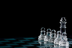 Chess. Strategic games; chess; king and five pawns on chess board royalty free stock images