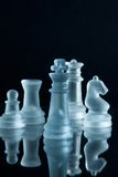 Chess. Some chess pieces illuminated by blue light Royalty Free Stock Photo