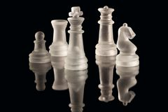 Chess. Some chess pieces illuminated by white light Stock Images
