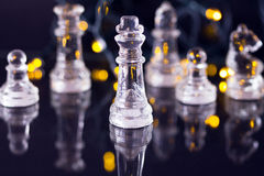 Chess. Some chess pieces illuminated by yellow light Stock Photography