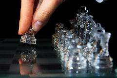 Chess. Glass game first starting move Royalty Free Stock Photos