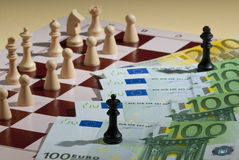 Chess. A chess game with bank-note Royalty Free Stock Photo