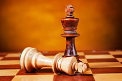Chess. Piece on wood board Stock Photography