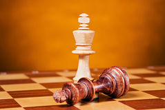 Chess. Piece on wood board Royalty Free Stock Image