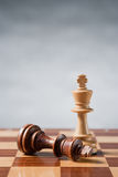 Chess. Pieces on wood board Royalty Free Stock Photography