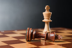 Chess. Pieces on wood board Stock Photo